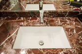 Sink in marble stand — Stock Photo