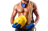 Muscular builder with tools isolated on white — Stock Photo