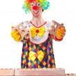 Bad construction concept with clown laying bricks — Stock Photo #14048511