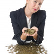 Stock Photo: Woman with lots of coins on white