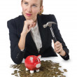 Woman breaking piggy bank for savings — Stock Photo