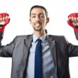 Handsome businessman with boxing gloves — Stock Photo #14049569