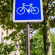 Royalty-Free Stock Photo: Bicycle sign on blue background