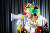 Clown in studio with loudspeaker — Stock Photo