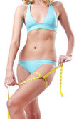 Young lady with centimetr in weight loss concept — Stock Photo