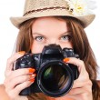 Attractive female photographer on white — Stock Photo