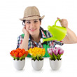 Stock Photo: Girl watering plants on white