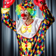 Royalty-Free Stock Photo: Funny clown in the studio shooting