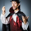 Magician doing tricks in dark room — Stock Photo