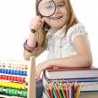 Girl with books and abacus — Stock Photo #14367843