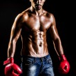 Muscular boxer in studio shooting — Stock Photo