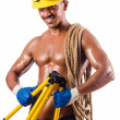 Stock Photo: Muscular builder with tools isolated on white