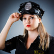 Attractive police office in dark room — Stock Photo