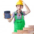 Expensive construction concept with builder and calculator — Stock Photo #14759329