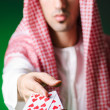Arab playing in casino - gambling concept with man - Stock Photo