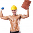 Muscular builder with bricks on white — Stock Photo #14766633