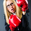 Stock Photo: Woman boxer in dark room