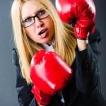 Woman boxer in dark room — Stock Photo
