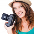 Attractive female photographer on white — Stock Photo #14769351