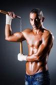 Strong man with nunchaku — Stock Photo