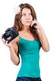 Attractive female photographer on white — Stock Photo