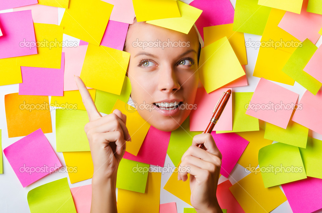 Woman with lots of reminder notes  Stock Photo #14770489