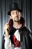 Magician doing tricks on white — Stock Photo