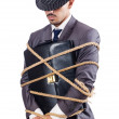 Businessman tied up with rope — Stock Photo