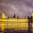 British parliament and Big Ben building at night - Stock Photo