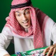 Arab playing in casino - gambling concept with man — Stock Photo #15752069