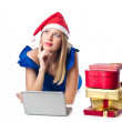Royalty-Free Stock Photo: Santa woman with laptop on white
