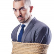 Businessman tied up with rope — Stock Photo #15754811