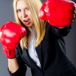 Woman boxer in dark room — Stock Photo