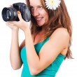 Stock Photo: Attractive female photographer on white