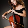 Woman performer with cello in studio — Stock Photo
