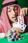 Arab playing in casino - gambling concept with man — Stock Photo