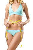 Woman in bikini in diet concept isolated on white — Stock Photo