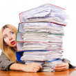 Stock Photo: Busy womwith stacks of paper