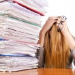 Busy woman with stacks of paper — Stock Photo