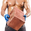 Sexy construction worker with bricks — Stock Photo