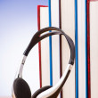 Concept of audio books with earphones on white — Stock Photo #16633579