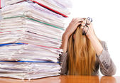 Busy woman with stacks of paper — Stockfoto