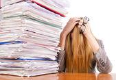 Mujer ocupada con pilas de papel — Foto de Stock