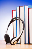 Concept of audio books with earphones on white — Stock Photo