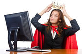 Superwoman worker with crown working in office — Stock Photo