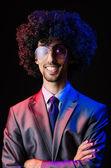 Singer with afro cut in dark studio — Stock Photo