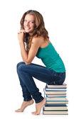 学生坐在书堆上 — 图库照片