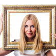 Woman with picture frame on white — Stock Photo
