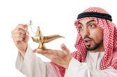 Hombre árabe con lámpara aislada en blanco — Foto de Stock