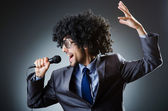 Man with afro haircut singing in studio — Stock Photo
